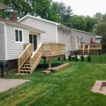 Newly installed insulated siding and deck at two neighbor's homes in Roseland, NJ.