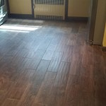 The new kitchen floor tiles in Hasbrouck Heights, NJ are simulated wood.