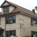 Newly installed GAF architectural shingle roof in Elizabeth, NJ. The fascia has been repaired on the right side.