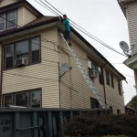 Installing the new seamless gutter along the right elevation of the home in Elizabeth, NJ.