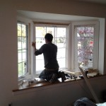 Installing new replacement windows in the bay window in the front of the house in Westfield, NJ.