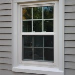 Exterior view of a vinyl replacement window in Westfield, NJ. The windows were wrapped with white PVC coated aluminum.