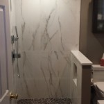 Bathroom renovation in Millburn, NJ included a new knee-wall with shower niche.