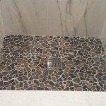 Custom tile floor installed in this shower in Millburn, NJ.