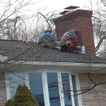 Installing new counterflashing around the chimney in Watchung, NJ.