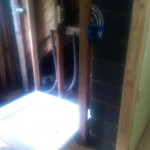The new bathroom space in Montclair, NJ with some rough plumbing installed.