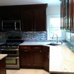 New granite counter tops and appliances were installed in this Teaneck, NJ kitchen.