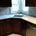 The two new replacement windows and relocated plumbing to center the sink in Teaneck, NJ.