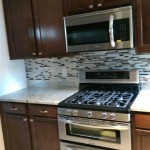 A new backsplash and appliances installed in Teaneck, NJ.