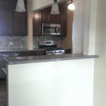 The completed kitchen and opening between the kitchen and dining room in Hasbrouck Heights, NJ.