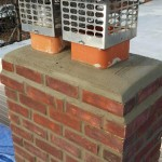 The rebuilt masonry chimney in Montclair, NJ with chimney caps.