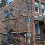 Setting up scaffolding along the side of the house in Montclair, NJ to begin repairing the brick.