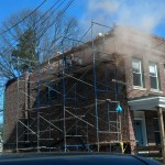 Installing new brick to the left side of the home in Montclair, NJ.