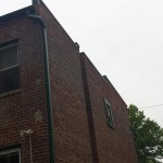 The brick work and roof is completed, along with new green coping at the top and a new gutter system in Montclair, NJ.