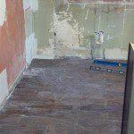 Installing the new kitchen floor tiles in Hasbrouck Heights, NJ.