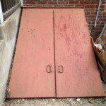 The basement bilco doors prior to refinishing in Montclair, NJ.