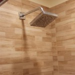 The completed tile shower with rain showerhead in this Nutley, NJ bathroom.