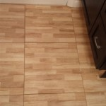 A close-up of the unique floor tiles in Nutley, NJ. The vanity cabinet has also been installed.