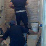 Installing tiles in this Nutley, NJ bathroom.