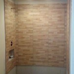 The shower tiles and floor tiles are being installed in this Nutley, NJ bathroom.