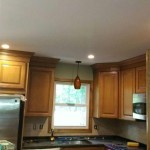 Completed kitchen in Chatham, NJ with new wood cabinets, stainless steel appliances, lighting, and granite countertops.