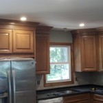 Almost completed kitchen in Chatham, NJ with new wood cabinets, stainless steel appliances, lighting, and granite countertops.